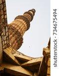 qutb minar temple complex | Shutterstock . vector #734675494