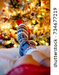 womans feet in woollen socks at ... | Shutterstock . vector #734677219