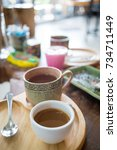 Small photo of Hot americano coffee on wood table