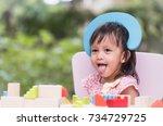 cute asian little girl is... | Shutterstock . vector #734729725