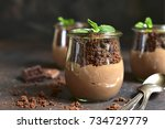 pots with chocolate pudding... | Shutterstock . vector #734729779