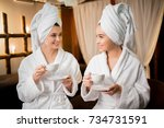 friendly girls in bathrobes and ...   Shutterstock . vector #734731591