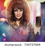 beautiful woman holding a new...   Shutterstock . vector #734737009