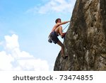 young male climbing on a cliff... | Shutterstock . vector #73474855
