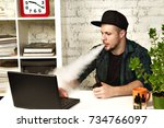 young man sitting in office...   Shutterstock . vector #734766097