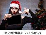 Young Beautiful Woman In Santa...