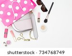 handbag in a shopping bag and... | Shutterstock . vector #734768749