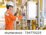 production operator operate... | Shutterstock . vector #734770225