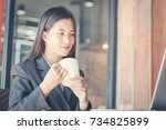 young businesswoman on a coffee ... | Shutterstock . vector #734825899