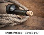 old  bottle of wine on the board   Shutterstock . vector #73483147