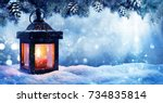 christmas lantern on snow with... | Shutterstock . vector #734835814