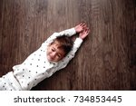 top view of little boy while... | Shutterstock . vector #734853445