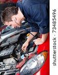 handsome mechanic working in... | Shutterstock . vector #73485496