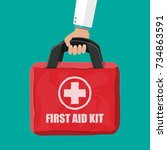 first aid kit in hand of doctor....   Shutterstock .eps vector #734863591