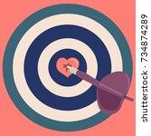 dart hit the heart in the... | Shutterstock .eps vector #734874289