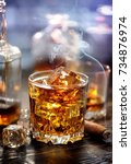 cigar on glass of whiskey with... | Shutterstock . vector #734876974