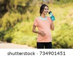a woman in a pink t shirt is... | Shutterstock . vector #734901451