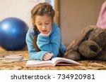 young girl reading in children... | Shutterstock . vector #734920981