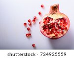 Half Pomegranate With Seeds On...