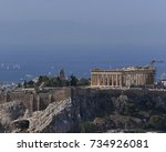 Small photo of Athens Greece, Parthenon temple and blue sea as a distant background