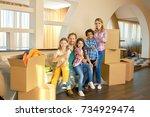 family showing thumbs up indoor.... | Shutterstock . vector #734929474