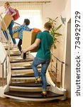 people carrying boxes upstairs. ... | Shutterstock . vector #734929729