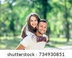 outdoors portrait of lovers... | Shutterstock . vector #734930851