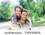 outdoors portrait of lovers... | Shutterstock . vector #734930854