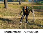 Small photo of Belarus, Bobruisk district, the village Clear Forest, 17 October 2015: Man pulls out of the ground dried got along trees to replace them with new, young plants