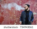 young stylish bearded man in a... | Shutterstock . vector #734943061