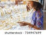 woman in hat looking to... | Shutterstock . vector #734947699
