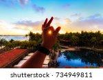 sunset between fingers... | Shutterstock . vector #734949811