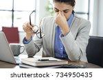 businesswoman rubbing her tired ... | Shutterstock . vector #734950435