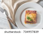 portion of lasagne on the... | Shutterstock . vector #734957839