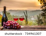 red wine bottle and wine glass... | Shutterstock . vector #734961307