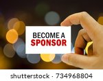 Small photo of become a sponsor written on business card man hand holding
