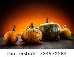 pumpkins on planks  | Shutterstock . vector #734972284