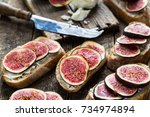 sandwich with figs and goat... | Shutterstock . vector #734974894