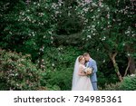 stunning wedding couple stands... | Shutterstock . vector #734985361