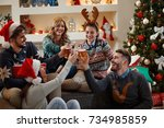 group of young people toasting... | Shutterstock . vector #734985859