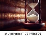 old books and hourglass in... | Shutterstock . vector #734986501