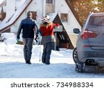 back view of skiers going back... | Shutterstock . vector #734988334