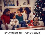 family for christmas eve at... | Shutterstock . vector #734991025