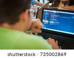 young man programming on a... | Shutterstock . vector #735002869