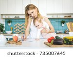 young mother with her baby... | Shutterstock . vector #735007645