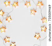 star shaped christmas lights... | Shutterstock . vector #735009469