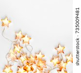 warm star shaped light garlands ... | Shutterstock . vector #735009481