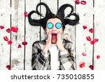 pretty brunette girl relaxing... | Shutterstock . vector #735010855