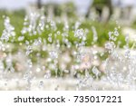 fountain bubbling up water jets ... | Shutterstock . vector #735017221