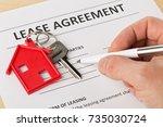 man holding pen over house door ... | Shutterstock . vector #735030724